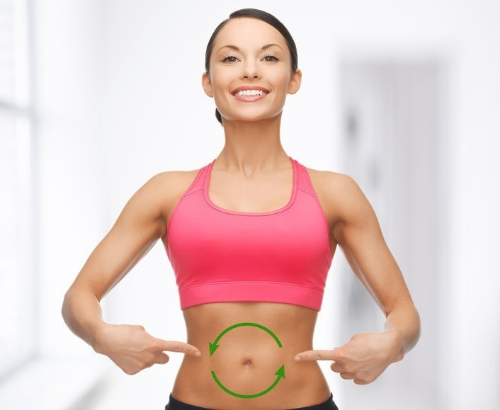 Woman with Green arrows making a circle on her stomach